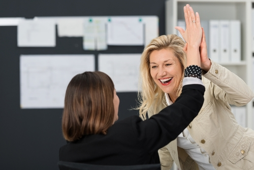 women-high-five